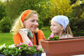Happy mother and daughter having gardening time - planting flowers - PhotoDune Item for Sale