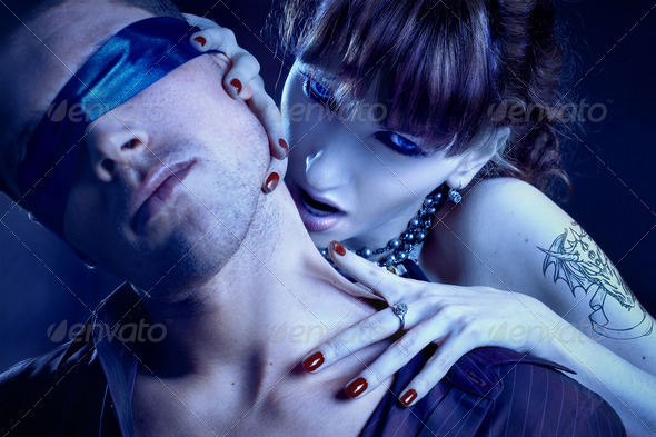 woman vampire bites a blind man - Stock Photo - Images