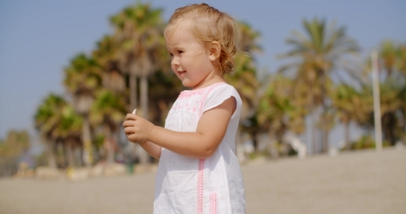 VideoHive Young Blond Girl In White Dress On Tropical Beach 12279672