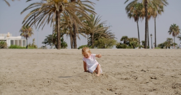 VideoHive Young Beautiful Girl Playing In Sand 12279677