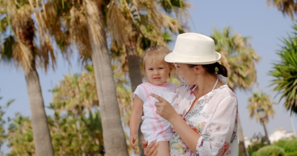 VideoHive Mom Carrying Her Little Daughter At The Resort 12279693