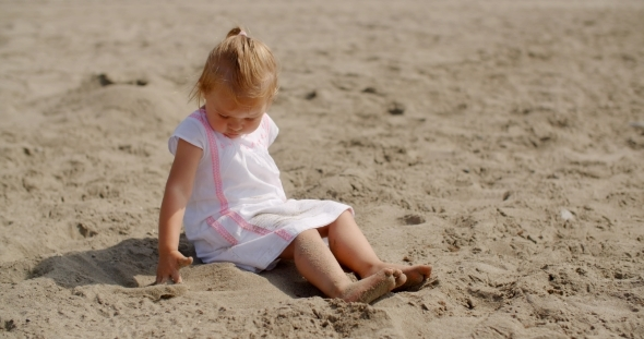 VideoHive Young Beautiful Girl Playing In Sand 12279707