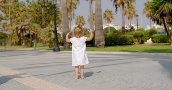 VideoHive Small Girl Chasing Air Bubbles 12279740