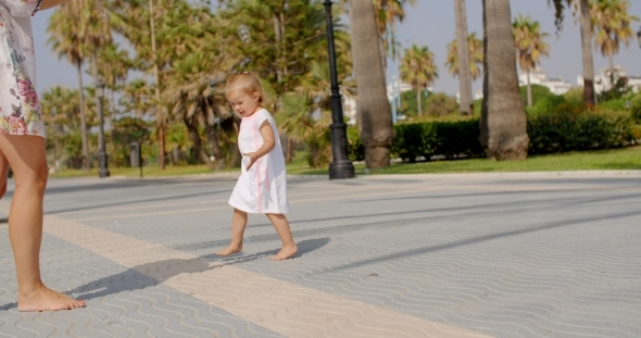 VideoHive Small Girl Chasing Air Bubbles 12279742