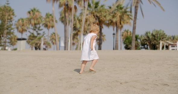 VideoHive Cute Blond Girl At The Beach On a Tropical Weather 12279747