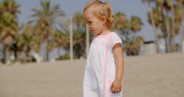 VideoHive Cute Blond Girl At The Beach On a Tropical Weather 12279752