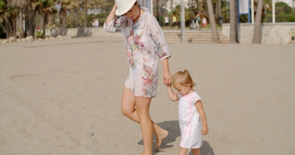VideoHive Mother With Her Daughter Walking At The Beach 12279755