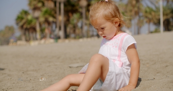 VideoHive Cute Young Girl Playing On Sandy Tropical Beach 12279759