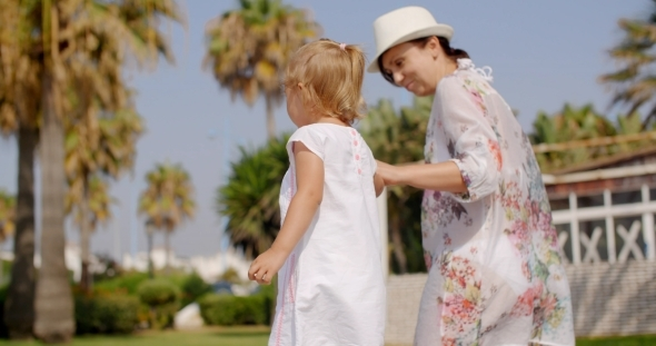 VideoHive Small Girl Walking With Mother 12279808