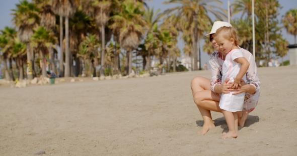 VideoHive Mom And Daughter At The Beach On a Very Sunny Day 12279811