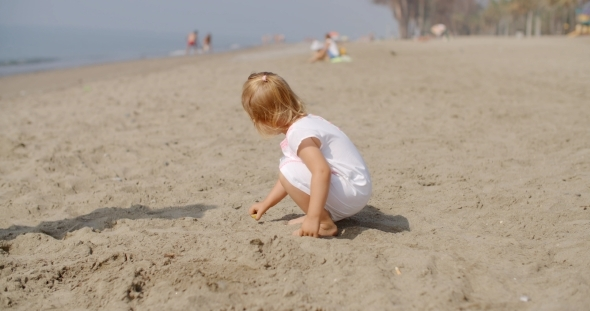 VideoHive Young Child Playing On Sandy Beach 12279816