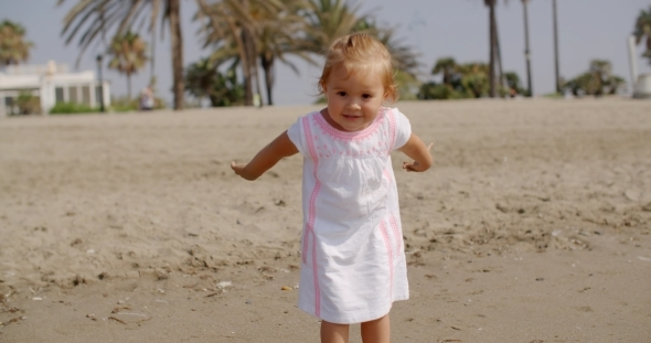 VideoHive Cute Little Girl Playing On The Beach 12279826