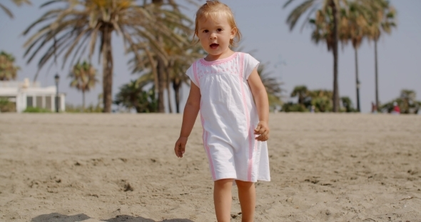 VideoHive Cute Little Girl Walking On The Beach 12279831