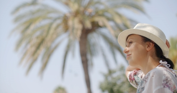 VideoHive Woman Looking Into The Distance On Palm Beach 12279836