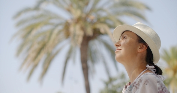 VideoHive Woman Looking Into The Distance On Palm Beach 12279843