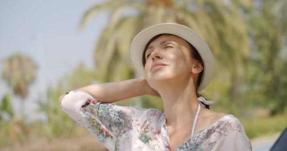 VideoHive Woman Looking Into The Distance On Palm Beach 12279865