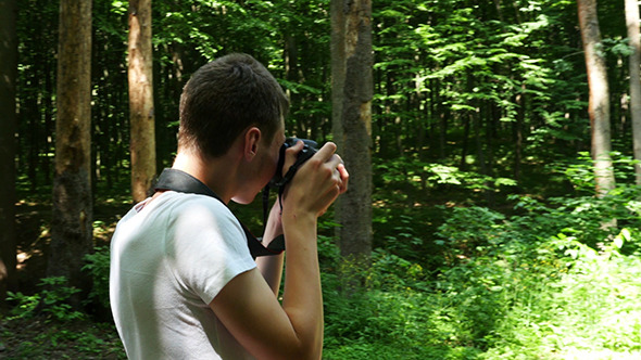 VideoHive Teen In Wilderness Area Taking Picture 12281991