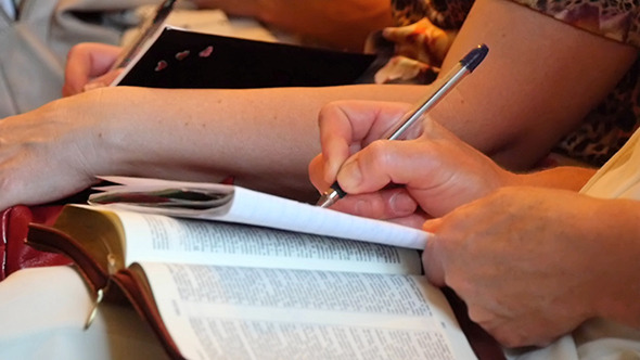 VideoHive Woman Writes A Pen In A Notebook 12282074