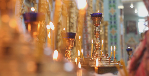 VideoHive Woman Lights Candles in Church 12294156