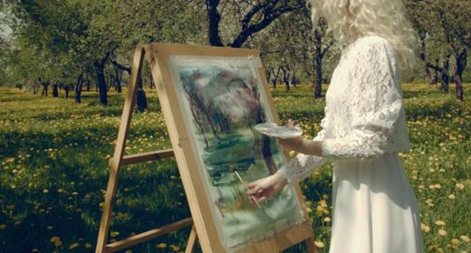 Creative Artist In The Blooming Garden