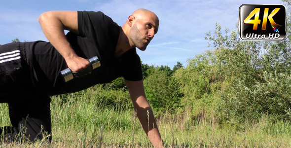 VideoHive Man Training in Nature On Grass 12307415