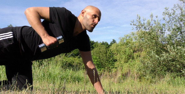 VideoHive Man Training in Nature On Grass 12307614