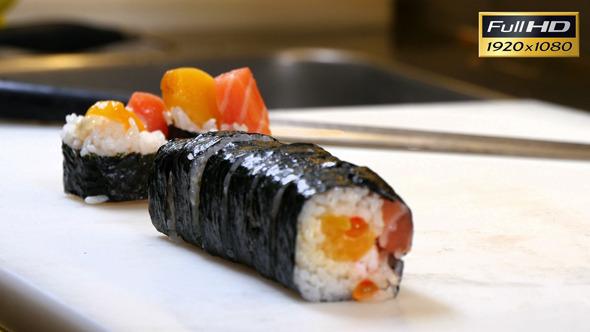 VideoHive Sushi Chef Presenting Salmon Peach Futomaki Roll 12314548