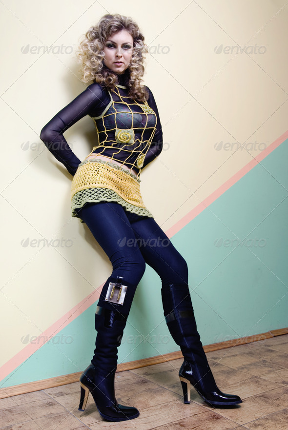 attractive woman posing against the wall - Stock Photo - Images