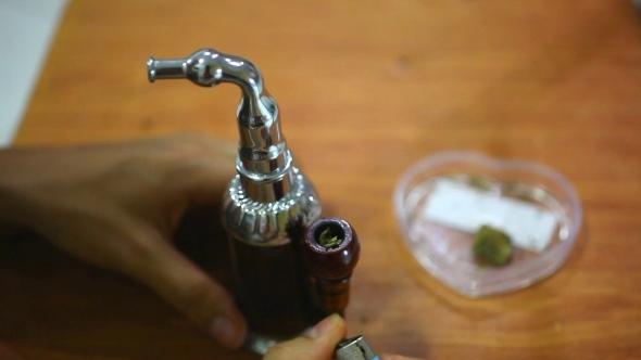 VideoHive Laying Of Marijuana In a Hookah Smoking And Smoke 12335445
