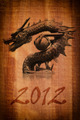 Dragon statue on the wood texture. - PhotoDune Item for Sale
