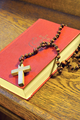 Hymnal  book and wooden rosary bead - detail - PhotoDune Item for Sale