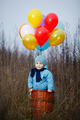 little boy wants to fly on balloons