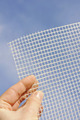 Detail of glass fiber mesh in hand – reinforcing material for insulation - PhotoDune Item for Sale