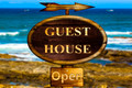 Wooden Guest house sign.