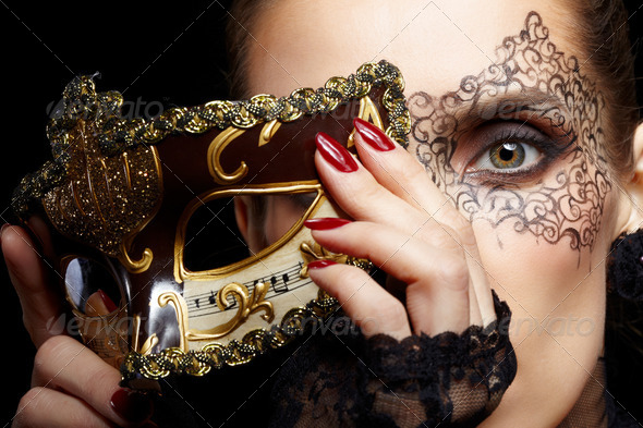 gorgeous woman in mask - Stock Photo - Images