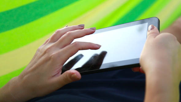 Girl Looks Pictures on the Touch Screen - 4