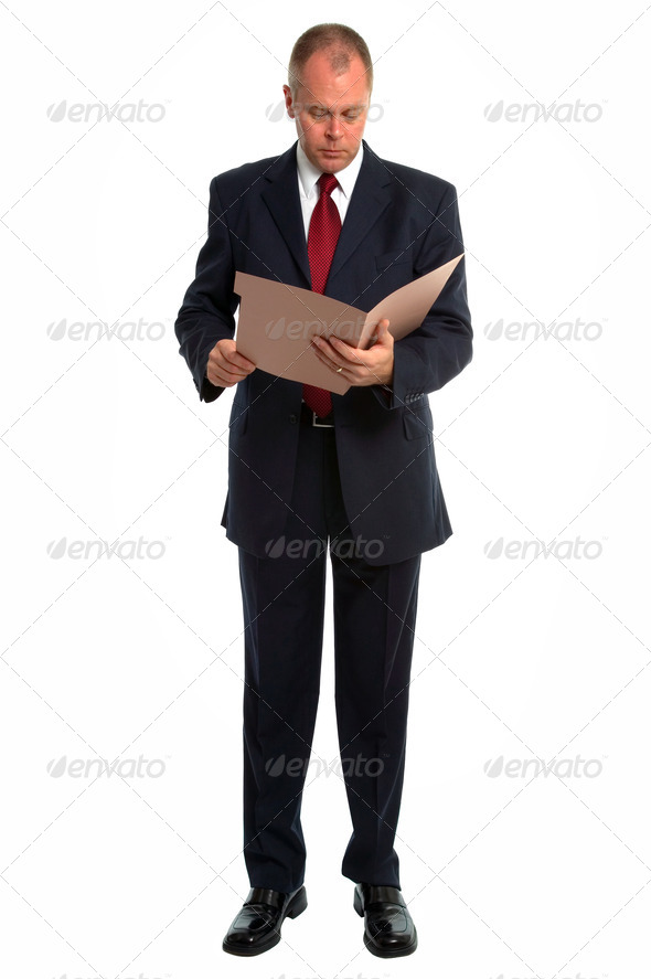 Businessman reading a file - Stock Photo - Images