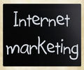 """""""Internet marketing"""" handwritten with white chalk"""