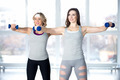 Team of sporty young females having intensive aerobics training