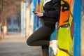 Runner girl with mobile phone, close-up