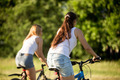 Young female friends riding bikes