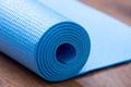 Folded blue yoga mat