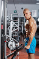 Triceps workout at a cable machine
