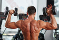 Fitness man doing shoulder and triceps workout