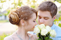 Beautiful sensual wedding couple and gentle bouquet of flowers