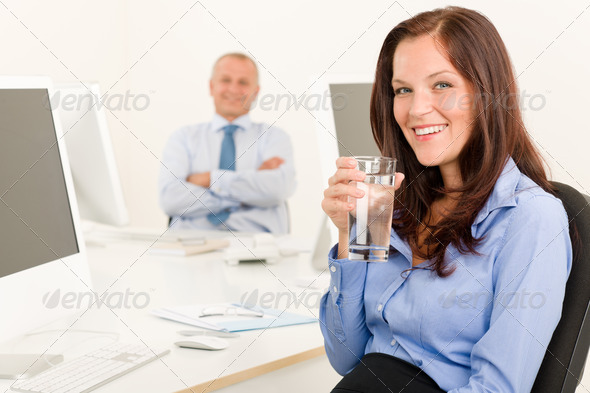 Businesswoman pretty smile sit in office colleague - Stock Photo - Images
