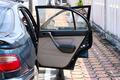 car with open door, outdoors