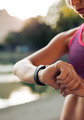 Fitness woman checking her performance on smartwatch