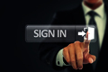 Businessman push to sign in button on virtual screen