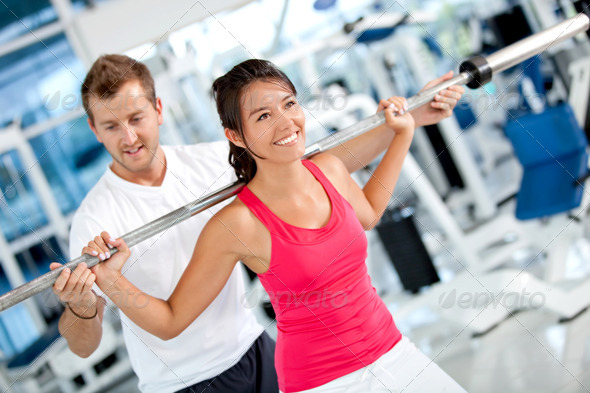 Gym woman with her trainer - Stock Photo - Images